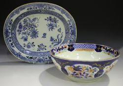A Chinese blue and white export porcelain oval dish, Qianlong period, painted with flowers within