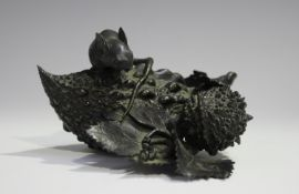 A Japanese brown patinated bronze figure group, Meiji period, finely modelled as a rat seated upon a