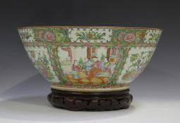 A Chinese Canton famille rose porcelain punch bowl, late 19th century, typically painted with panels