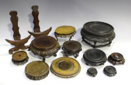 A collection of twenty-five mostly Chinese wood stands, late 19th century and later, including a