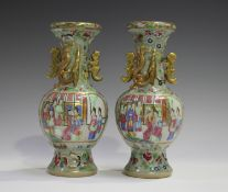 A pair of Chinese Canton famille rose enamelled celadon ground porcelain vases, mid to late 19th
