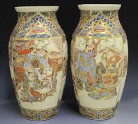 A pair of Japanese Satsuma earthenware vases, Meiji period, each painted and gilt with panels of
