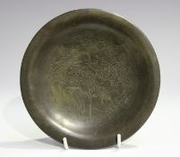A Chinese wire inlaid bronze circular dish, Qing dynasty, the central panel finely inlaid with a