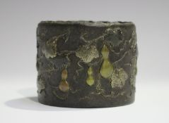 A Japanese mixed metal decorated iron cylindrical pot, Meiji period, cast in relief with a
