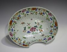 A Chinese famille rose export porcelain barber's bowl, Qianlong period, of fluted oval form, painted