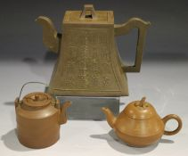 A Chinese Yixing stoneware teapot and cover, 20th century, of rectangular bell form, one side