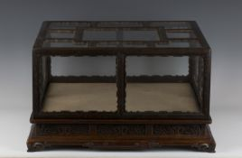 A Chinese silver wire inlaid hardwood and glazed table top display case and stand, late Qing