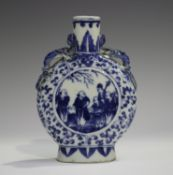 A Chinese blue and white porcelain moonflask, late 19th century, painted with opposing figural