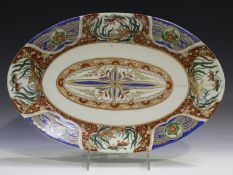 A Japanese Imari porcelain oval dish, Meiji period, painted and gilt with a central foliate