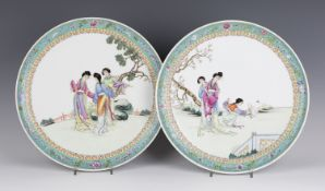 A pair of Chinese famille rose porcelain circular dishes, mark of Qianlong but probably Republic