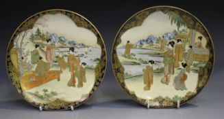 A pair of Japanese Satsuma earthenware side dishes, Meiji period, each painted and gilt with a scene