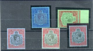 A collection of Bermuda stamps from 1922 with 1924 to 32 high values mint, three 10 shillings 12/