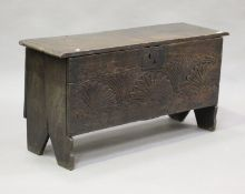 A late 17th century oak six plank boarded coffer, the front with later carved decoration, height