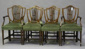 A set of eight Edwardian Neoclassical Revival mahogany and inlaid shield back dining chairs,