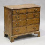 A George III oak chest of four graduated long drawers, on bracket feet, height 85cm, width 88cm,