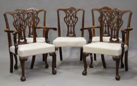 A set of ten 20th century George III style mahogany dining chairs, the finely carved pierced splat