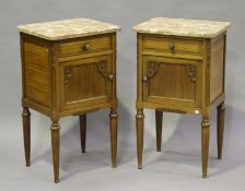 A pair of mid-20th century French walnut bedside cabinets with marble tops, height 80cm, width 45cm,