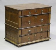 A Queen Anne oak chest of four long drawers, on stile supports, height 81cm, width 89cm, depth