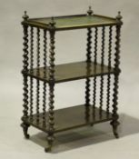 A mid-Victorian rosewood three-tier whatnot, the top inset with leather, raised on barley twist