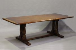 A modern Jacobean Revival oak refectory dining table by the Royal Oak Furniture Company, the seven-