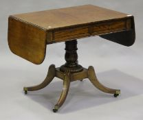 A Regency mahogany and brass inlaid sofa table with ebony stringing and oak-lined drawers, height