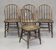 A set of four late 19th/early 20th century ash and elm hoop back kitchen chairs with turned