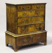 A George I walnut chest-on-stand with overall crossbanded borders, height 118cm, width 104cm,
