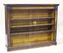 An early Victorian mahogany open bookcase with ebony stringing and applied flowerhead mounts, fitted