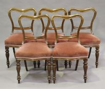 A set of nine early Victorian mahogany spoon back dining chairs and a later made copy, all with pink