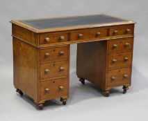 A Victorian mahogany twin-pedestal campaign desk, possibly naval, the top inset with gilt tooled