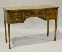 A late 20th century Neoclassical style mahogany serving table, the bowfront frieze fitted with