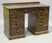 A Victorian mahogany twin-pedestal desk, fitted with an arrangement of eight drawers, height 80cm,