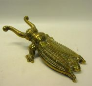 A late 19c cast brass beetle boot pull 28cm l.