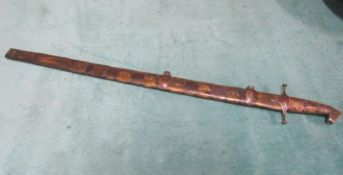 An Arabic Khevsors sword and sheath with a 70cm blade. 81cms l overall.