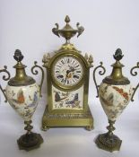 Late 19c French Garniture de Cheminée comprising a clock and two urns. The clock has a rectangular