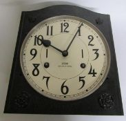 An early 20c movement from an industrial time clock complete with its mounting bracket now mounted