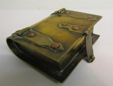 A Victorian brass book box with flap hinges and fastening. 8cms w.