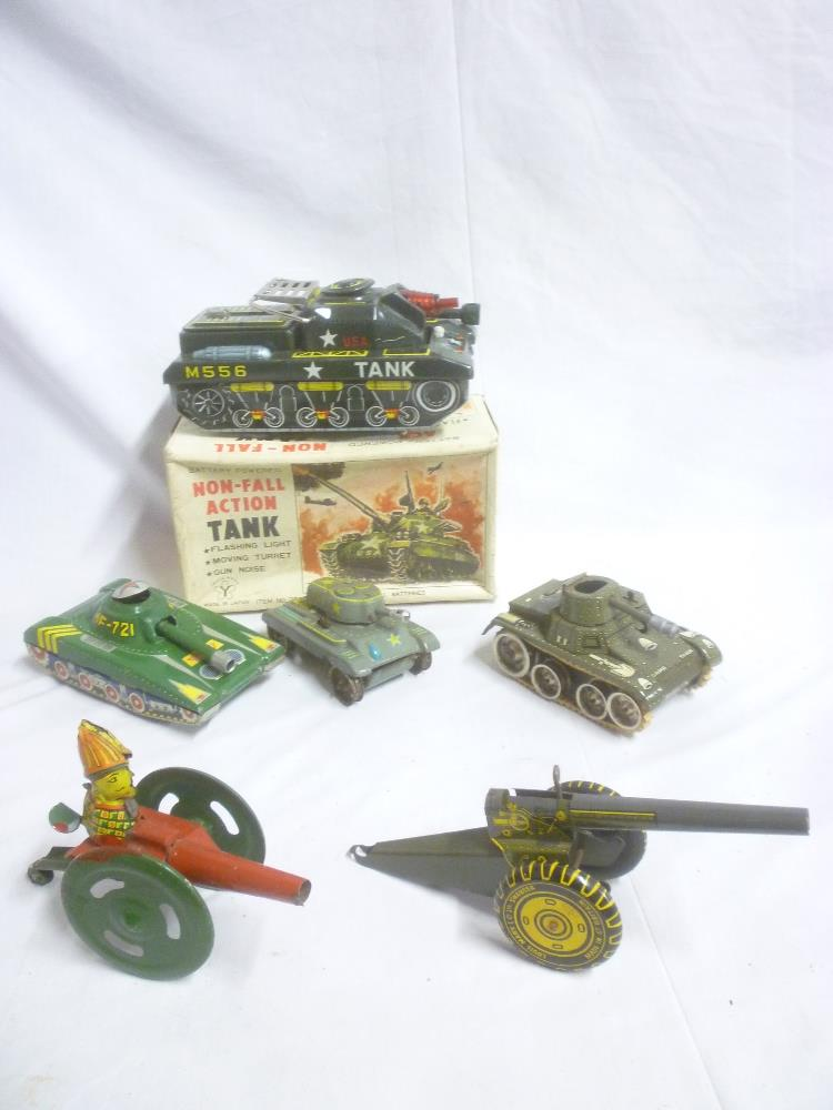 Lot 723 - A Japanese battery operated action tank in original box; Marx tin-plate field gun,