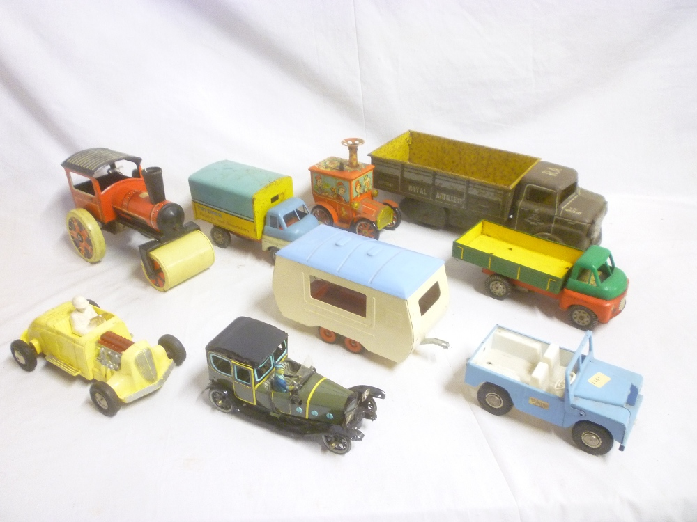 Lot 668 - A selection of various metal and tin-plate toys including Tri-ang Jeep with caravan,