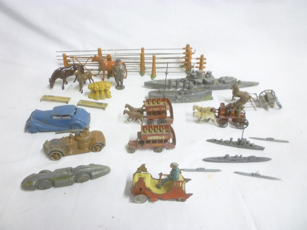 Lot 725 - A selection of various toys including early German tin-plate part vintage car,