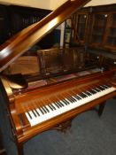 A good quality baby grand piano by R Gors & Kallmann of Berlin in polished rosewood case - movement