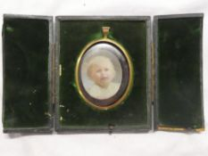 A miniature watercolour on ivory depicting bust portrait of a young child,