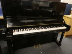 A high quality upright over-strung piano by Yamaha No.