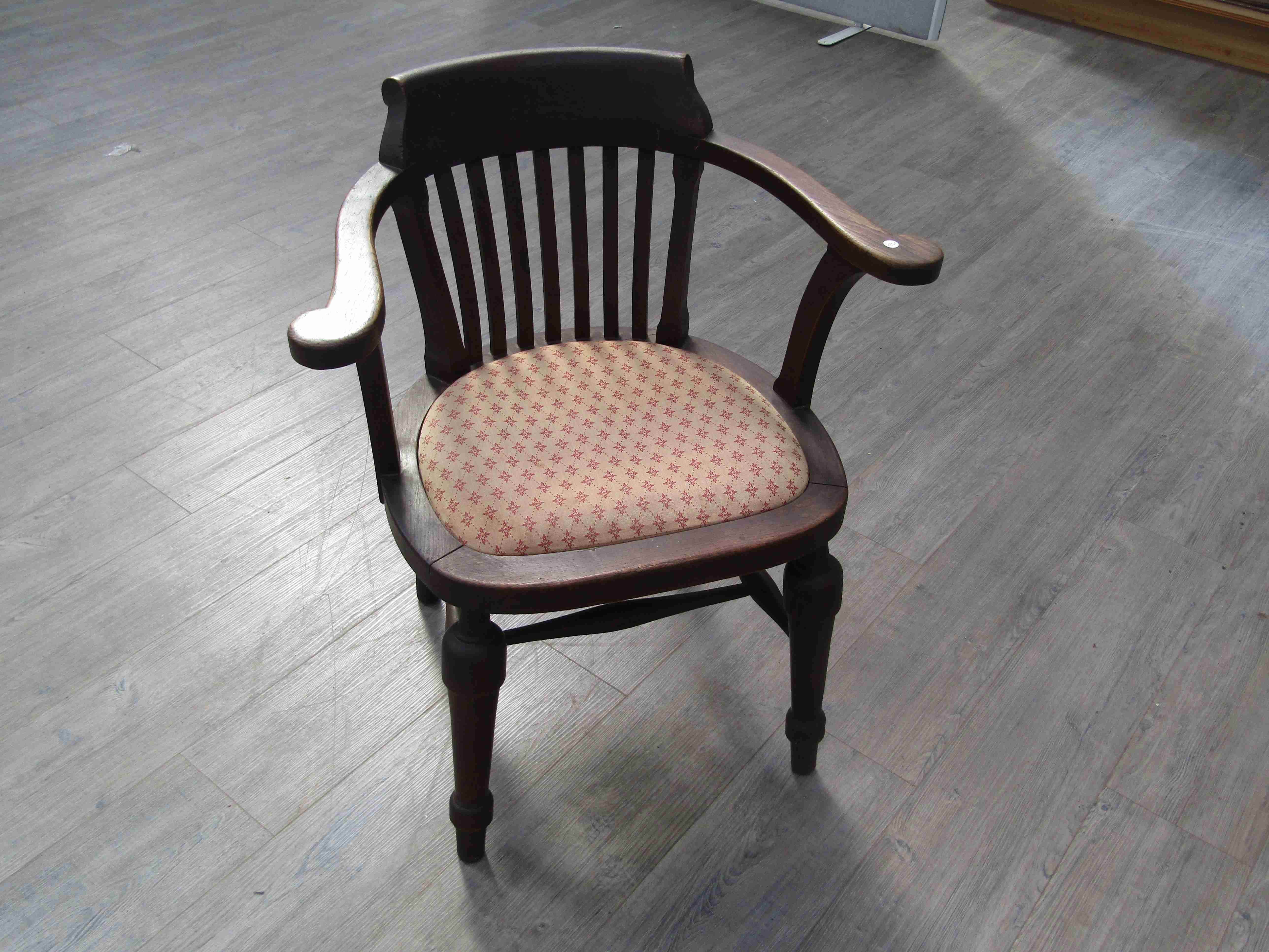 Lot 6021 - A 1940's oak military desk chair with slatted back, upholstered seat, on H-stretcher base,