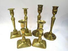Three pairs of 19th Century brass candlesticks