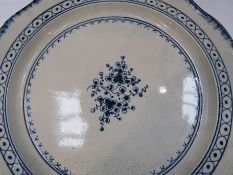 Two 18th Century blue and white chargers in the Worcester style, hairlines to both,