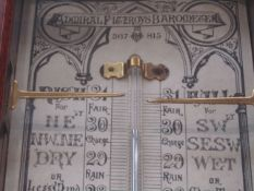 An Admiral Fitzroy barometer with paper charts,