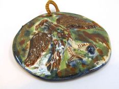 A small pottery plaque with relief of eagle,