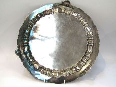A silver plated tray and a plated vessel holder, tray 35.