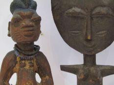 Three Polynesian tribal figures,